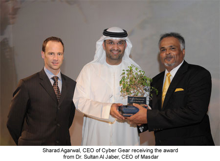 Sharad Agarwal, CEO of Cyber Gear receiving the award from Dr. Sultan Al Jaber, CEO of Masdar